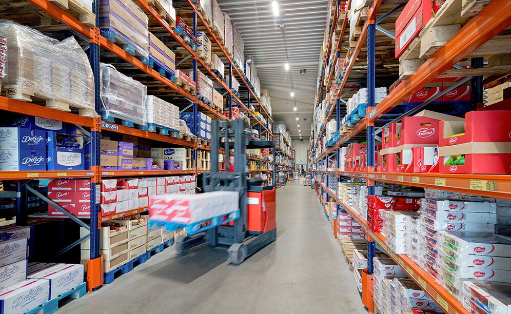 Pallet racks in the warehouse with Jot-Ł food and drinks