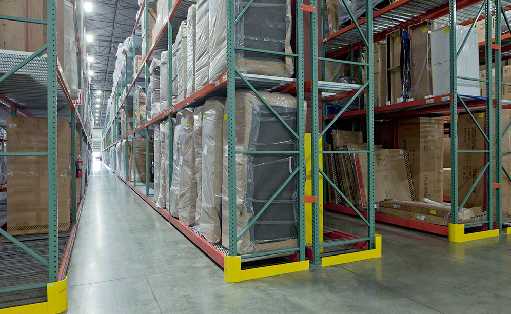 The pallet racks store various sizes of furniture