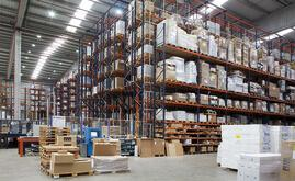 Next to the automated warehouse, six conventional double-depth pallet racks are arranged